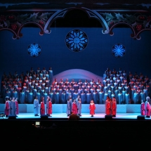 The Children's Choir lends its voice to the Christmas Cantata beneath gigantic boughs of holly.