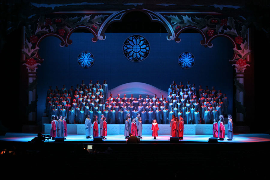 the childrens choir lends its voice to the christmas cantata beneath gigantic boughs of holly