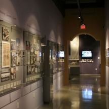 Even this narrow hallway became exhibit display space. Custom wall displays, designed by AST, showcase various historical photos.