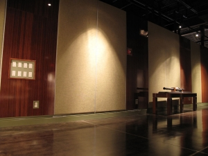 """To """"dress up"""" bare walls in an undeveloped section of the museum, AST Exhibits built and installed large decorative panels of fabric and bamboo plywood."""