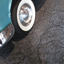 The tires were filled with foam to prevent them from going flat. AST Exhibits designed a special graphic for the floor that resembles asphalt cracking in the hot Florida sun.