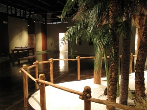 "The rustic cypress structures of the Calusa stand in stark contrast to the glossy wood finishes seen across the room in the ""soon to be built"" exhibit featuring Spanish Exploration."