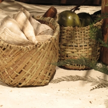 Hand-woven baskets made from local grasses were commissioned by AST Exhibits to complete this scene.