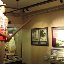 A Seminole glides through the Native People's Room standing atop his dugout canoe.
