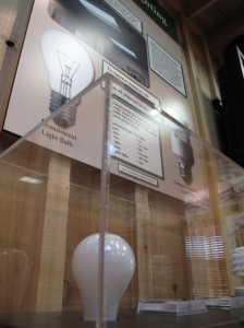 This simple interactive display shows the power that can be saved by using fluorescent light bulbs.